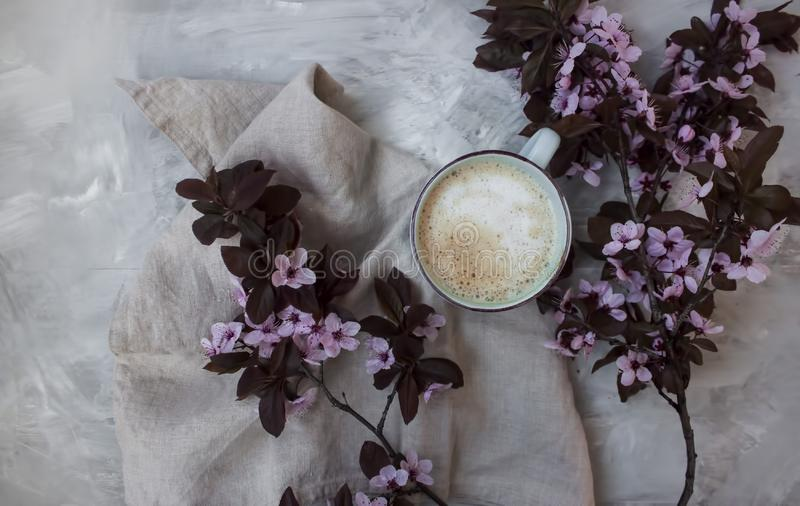 Top view background of pastel pink flowers and a warm cup of coffee stock photography