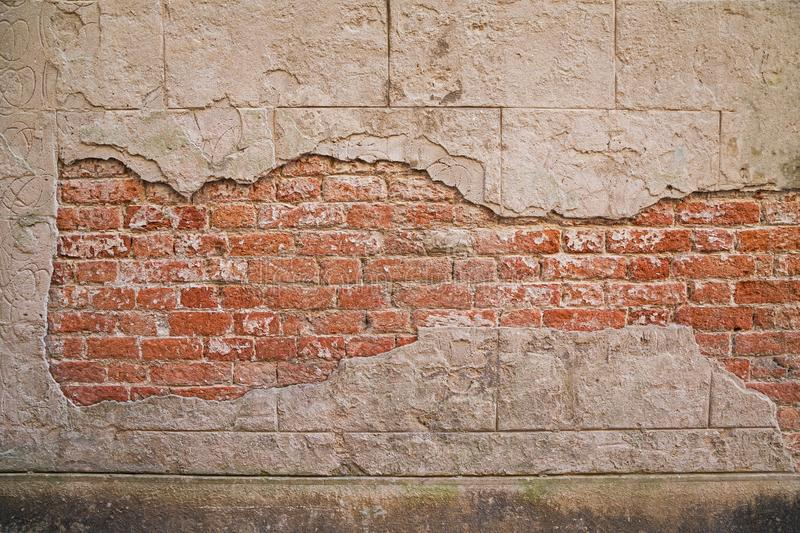 Background of crack color and cement concrete surface of antique abandoned house. can see texture of old red brick wall in side royalty free stock photo