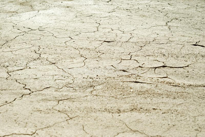 Background - cracked dry clay crust in the desert. Background - cracked dry sun-dried clay crust in a waterless desert royalty free stock photography