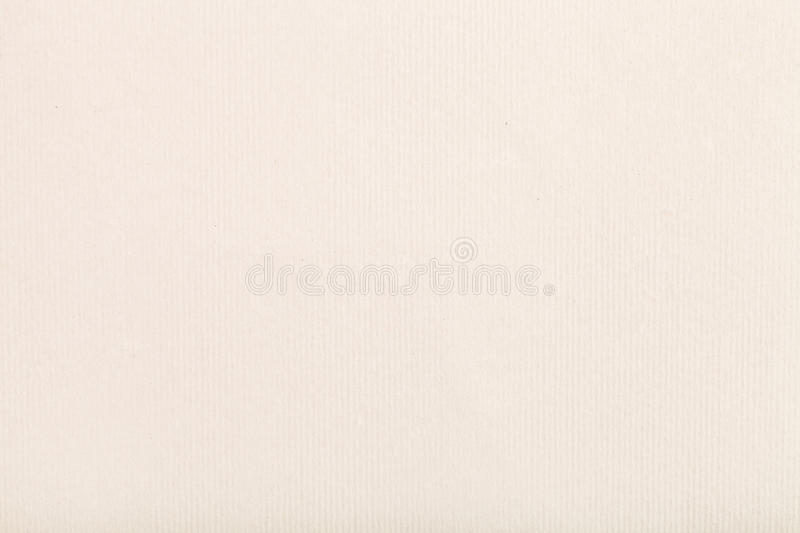Background from cream-coloured pastel paper stock photography