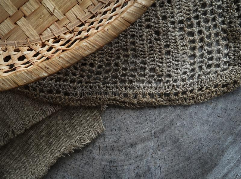 Background from cross section of tree trunk, natural linen napkins and a straw basket royalty free stock image