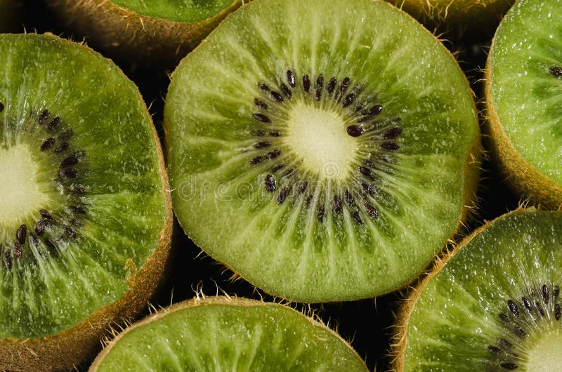 background from cut kiwis/background from cut kiwis. top view stock photography