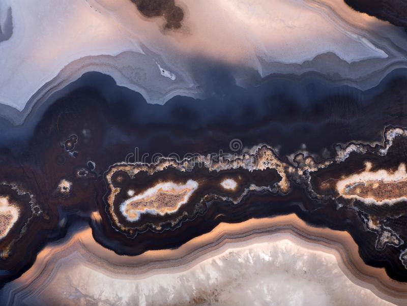 Background of dark agate structure. Background with contrast agate structure stock photo
