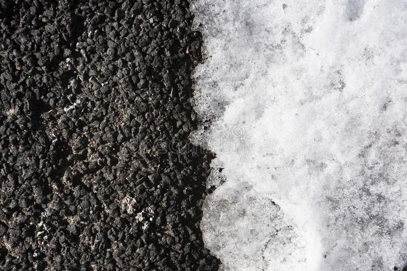 Background of dark asphalt with light snow in half from above. Background of dark asphalt with light snow in half royalty free stock photo