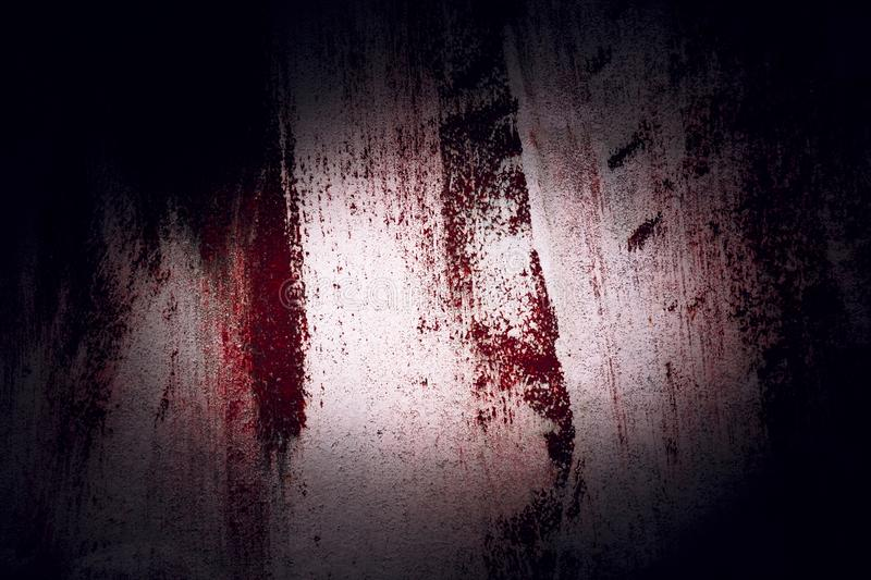 Background with dark black vignette horror style with the texture of old rusty metal. A wall with imitation of smeared blood to stock photography