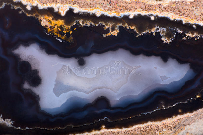 Background with dark blue agate structure. Background with contrast agate structure stock photos
