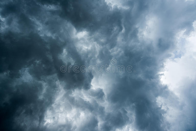 Background of dark clouds before a thunder-storm ,sunlight through very dark clouds background ,White Hole in the Whirlwind of dar. K storm clouds stock images