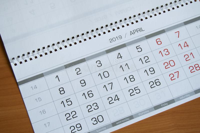 Background dates on the calendar page April 2019, on a wooden table.  stock image