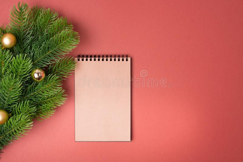 Background with decorated fir tree and blank notebook list in the middle. Top view with copy space. New year concept. Christmas concept. Winter concept royalty free stock photo