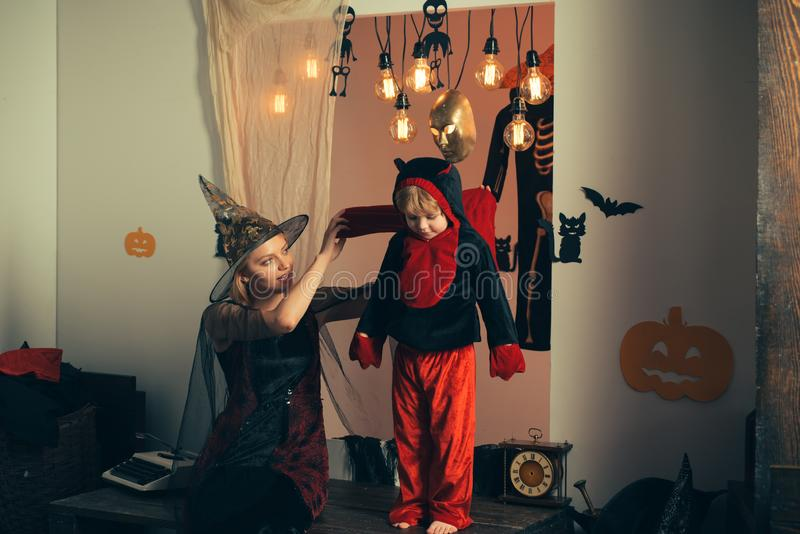 Family love and Halloween party. Close up shot of blond mom with little dressed boy, creepy costumes, eyewear and head royalty free stock photos