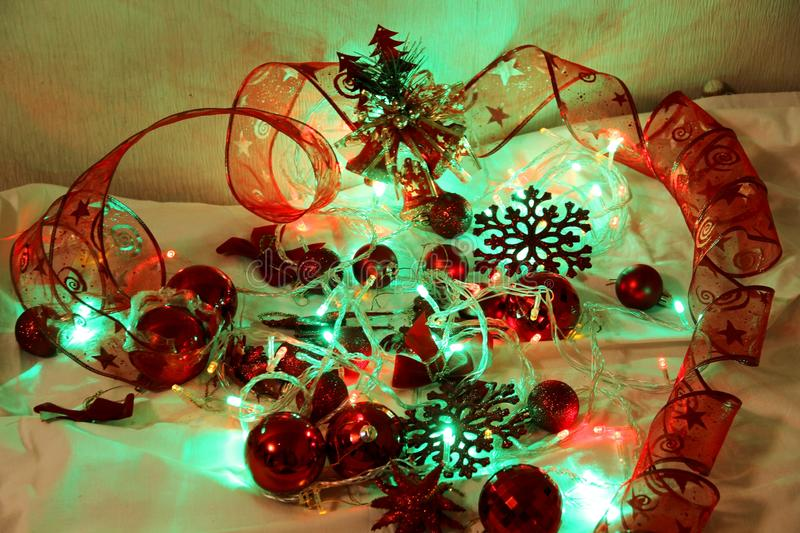 Colorful Christmas and new year background is decorated with lights of garlands, sparkling red balls, snowflake and decorative. Background is decorated with stock images