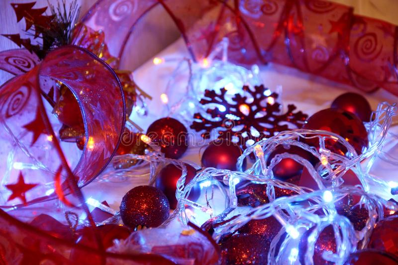 Colorful Christmas and new year background is decorated with lights of garlands, sparkling red balls, snowflake and decorative. Background is decorated with stock photography