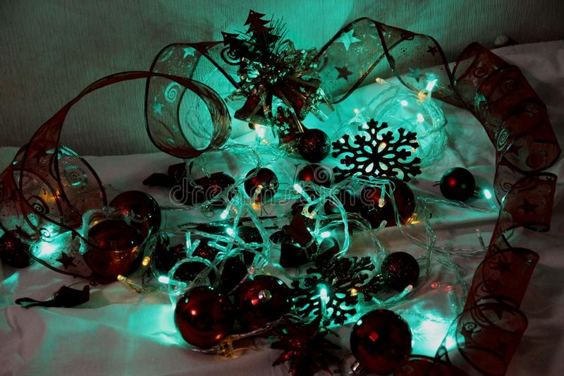 Colorful Christmas and new year background is decorated with lights of garlands, sparkling red balls, snowflake and decorative. Background is decorated with royalty free stock photo
