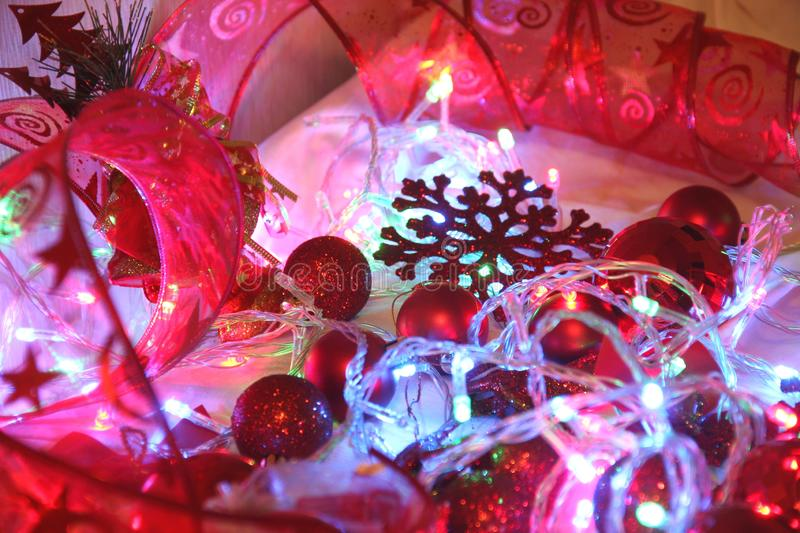 Colorful Christmas and new year background is decorated with lights of garlands, sparkling red balls, snowflake and decorative. Background is decorated with royalty free stock images