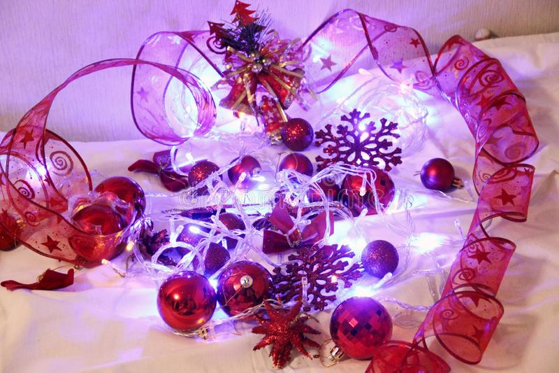 Christmas and Valentin background is decorated with lights of garlands, sparkling red balls, snowflake and decorative. Background is decorated with lights of royalty free stock photos