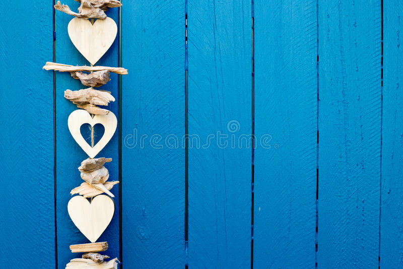 Background - Decorative drift wood hearts hanging on fence stock photo