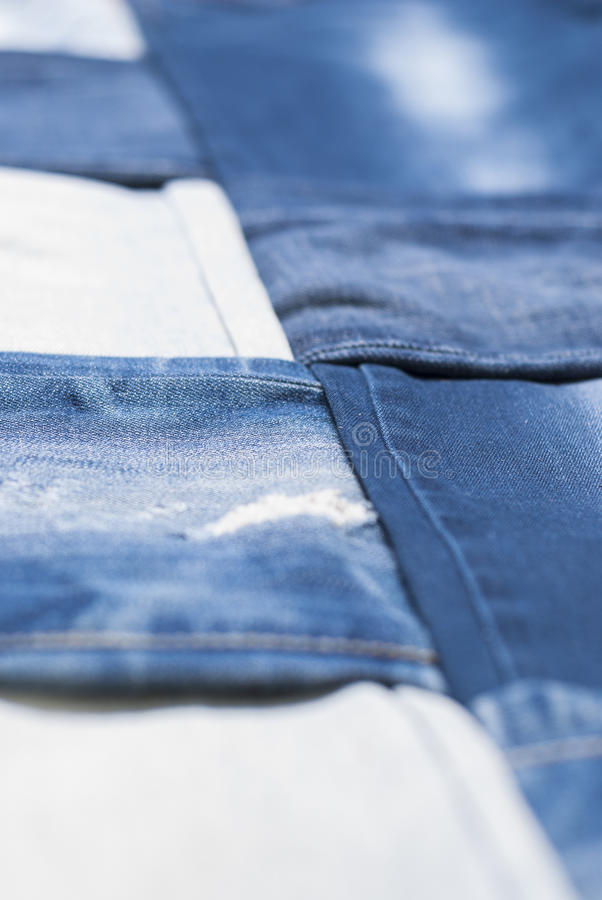 Background denim pants. Background made weave several pairs of denim pants royalty free stock photography