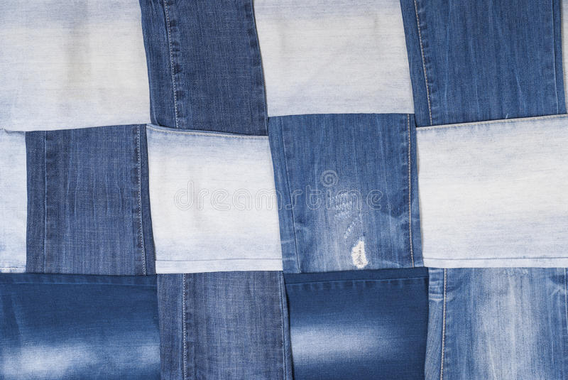 Background denim pants. Background made weave several pairs of denim pants royalty free stock photos