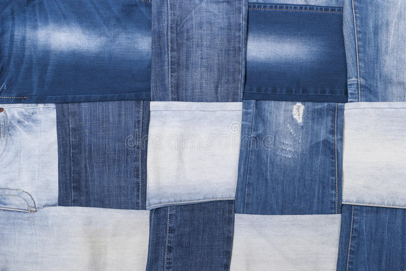 Background denim pants. Background made weave several pairs of denim pants royalty free stock images
