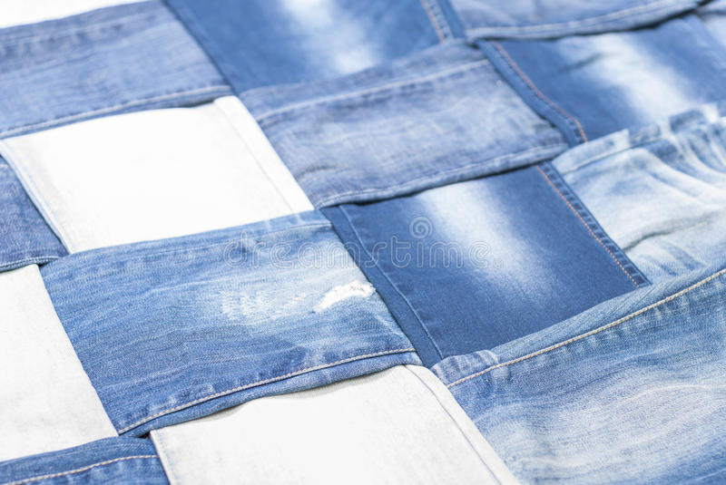 Background denim pants. Background made weave several pairs of denim pants stock photos
