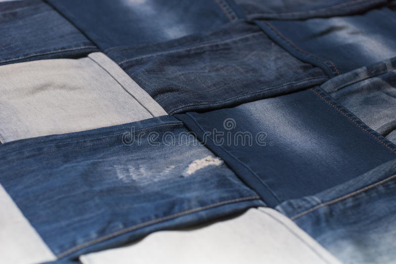 Background denim pants. Background made weave several pairs of denim pants royalty free stock image