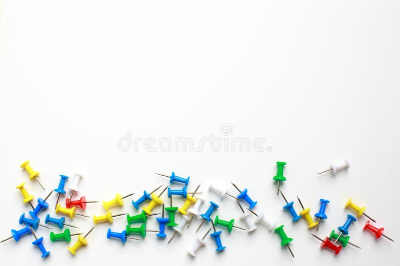 Multicolored clerical buttons on a white background royalty free stock photos