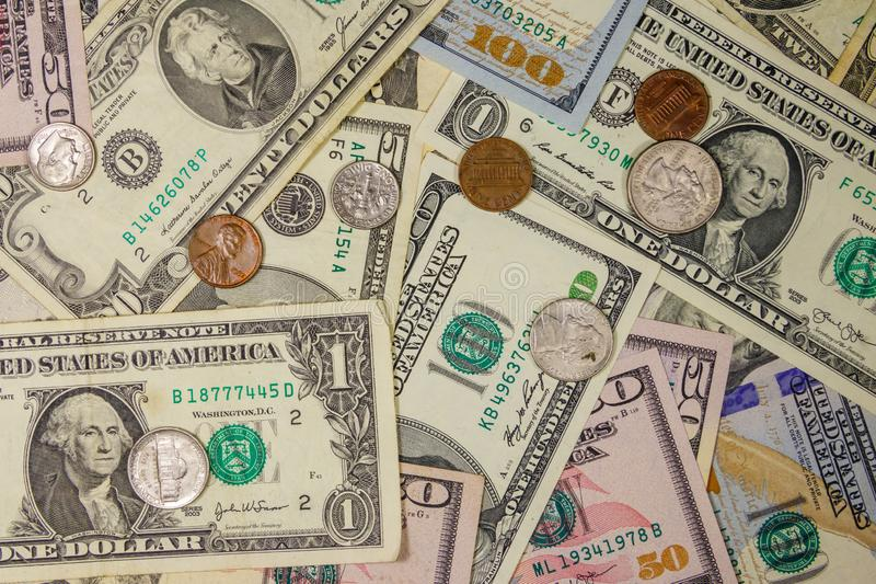 Background of different american dollars bills and coins royalty free stock photography