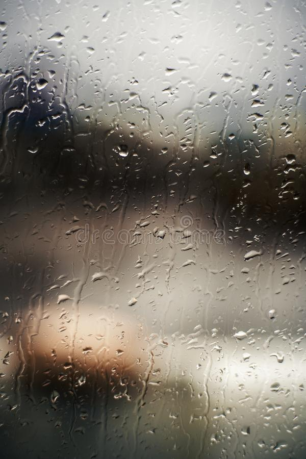 Background of drops on window on the navigational bridge. Ship stay in the port. stock image