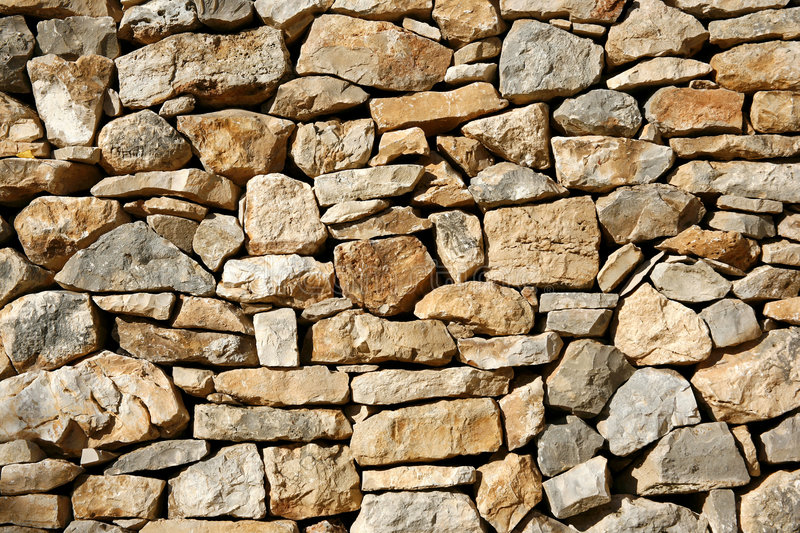 Background of dry limestone wall. With rocky structure stock photo