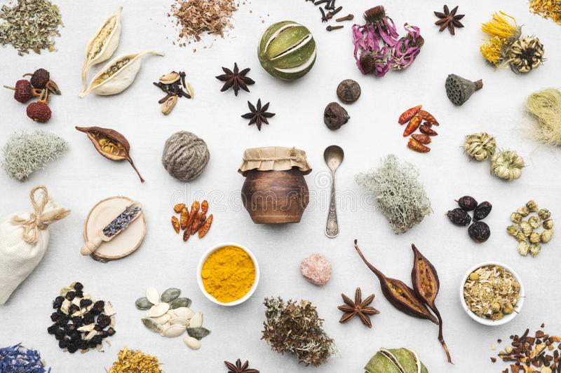 Background from dry medicinal herbs, plants, roots, ingredients for making herbal medicine remedies. stock images