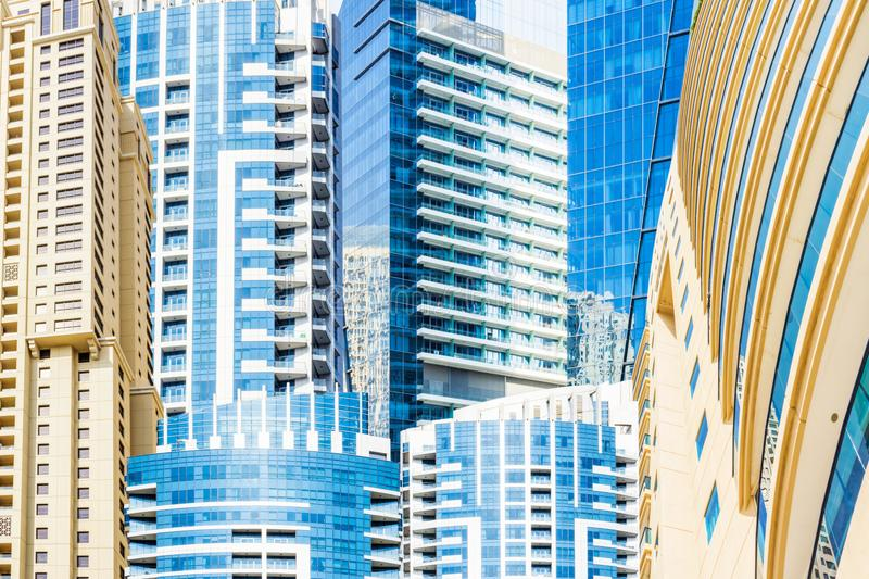 Background with Dubai skyscrapers. Composition with different facades of modern downtown Dubai skyscrapers royalty free stock photography