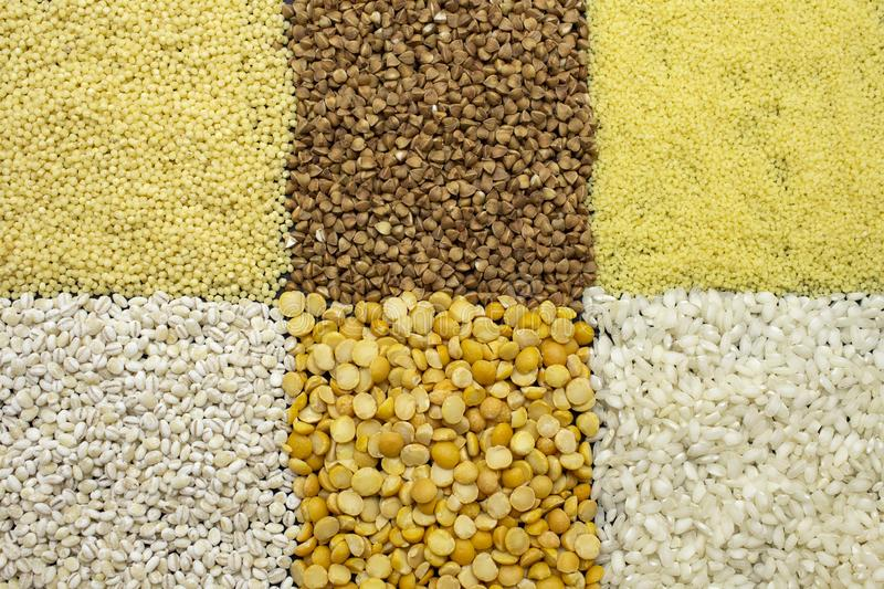 Background of dyfferent types of cereals. Nmillet, buckwheat, rice, peas, pearl barley, couscous.n stock photography