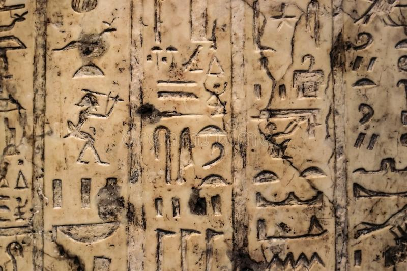 Background of Egyptian hieroglyphics carved in vertical rows into ivory royalty free stock image