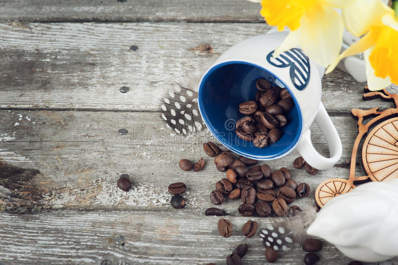 Background with empty blue coffee cup and beans. On wooden table. View from the top royalty free stock images
