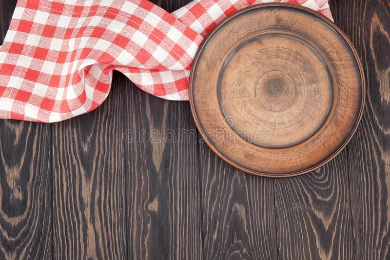 Plate on wooden table, red checkered napkin, tablecloth, food background, rustic, rustic style,space for text stock photo