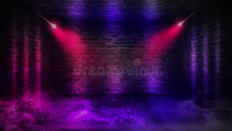 Background of an empty corridor with brick walls and neon light. Brick walls, neon rays and glow. Background of an empty dark-black room. Empty brick walls stock photography
