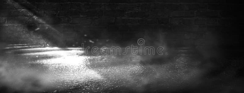 Background of an empty dark-black room. Empty brick walls, lights, smoke, glow, rays royalty free stock photos