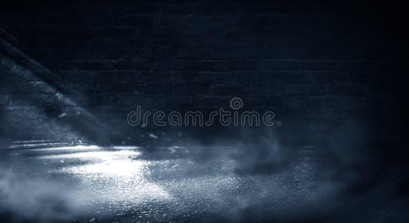 Background of an empty dark-black room. Empty brick walls, lights, smoke, glow, rays royalty free stock images