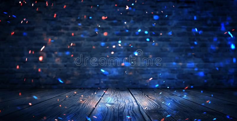 Dark basement room, empty old brick wall, sparks of fire and light on the walls and wooden floor. Dark background with smoke and b royalty free stock photos