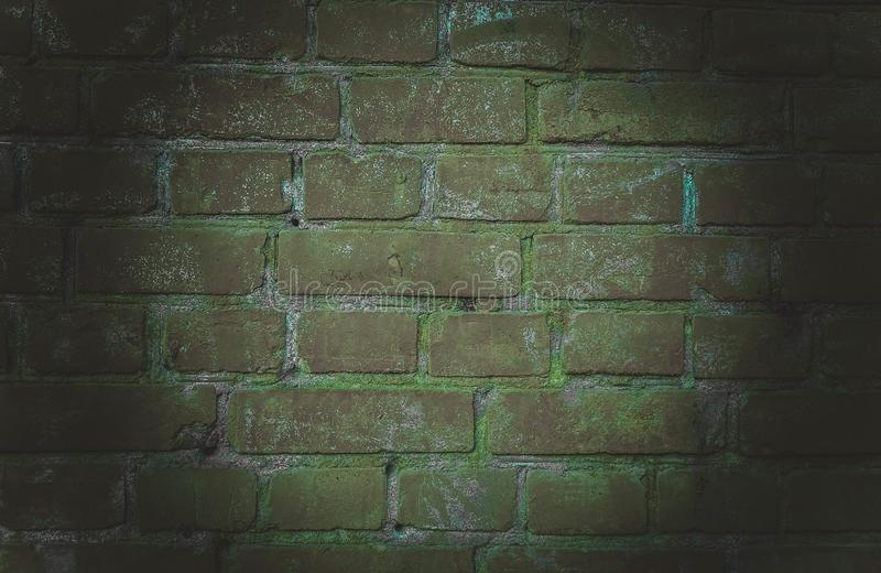 The background of an empty room with brick walls and concrete floor tiles. Neon light, spotlight royalty free stock photo