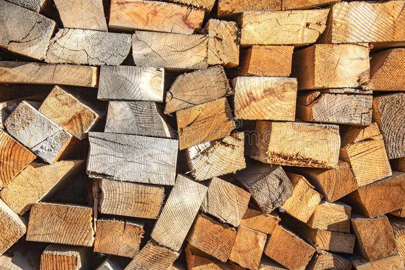 Background from the ends of natural wooden bars of various sizes closeup stock image
