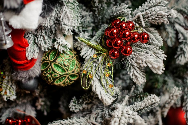 Background of evergreen fir tree with small red and green decoration stock images