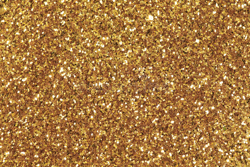 Background filled with shiny gold glitter. royalty free stock photography