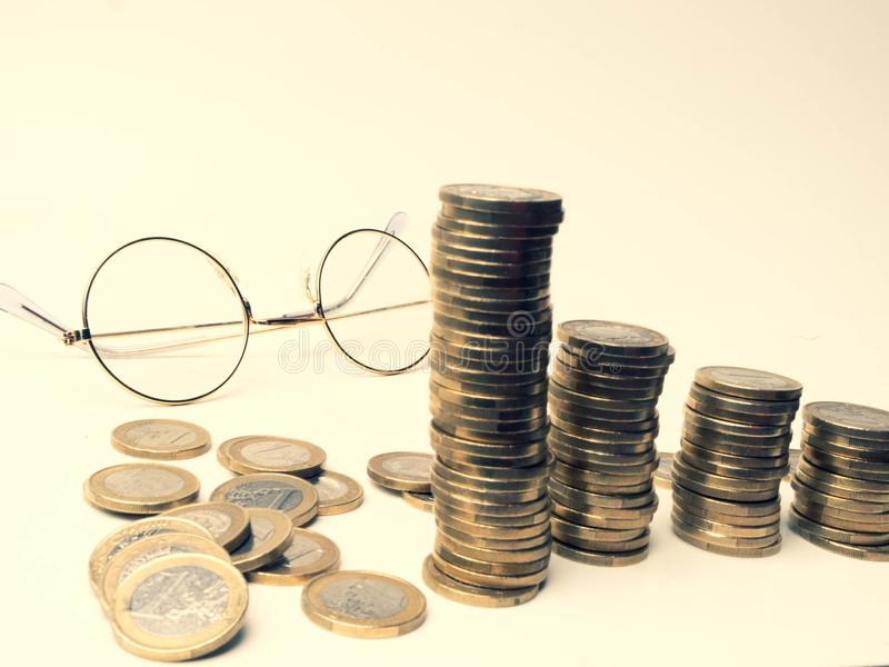 Background of financial and accounting concept with coin stacks, glasses, selective focus Concepts of tax planning. And budget management, selective focus stock photos