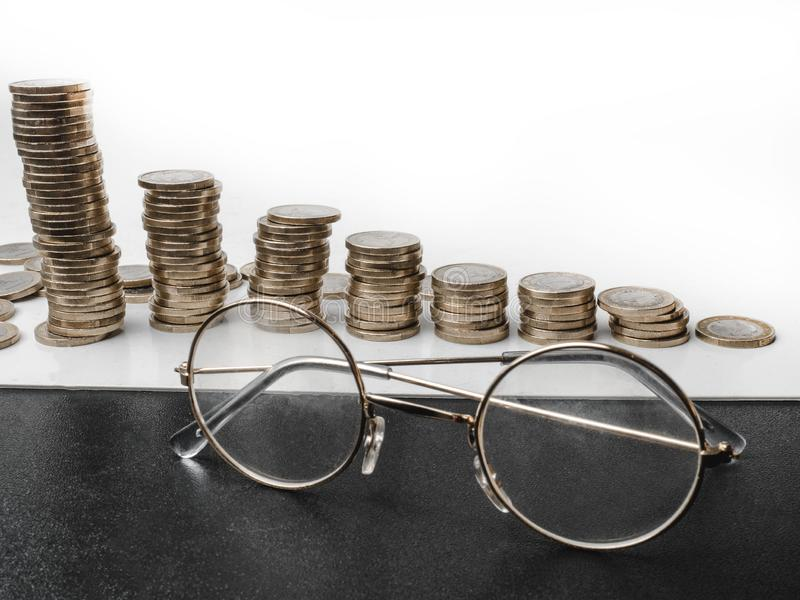 Background of financial and accounting concept with coin stacks, glasses, selective focus Concepts of tax planning. And budget management, selective focus royalty free stock photos