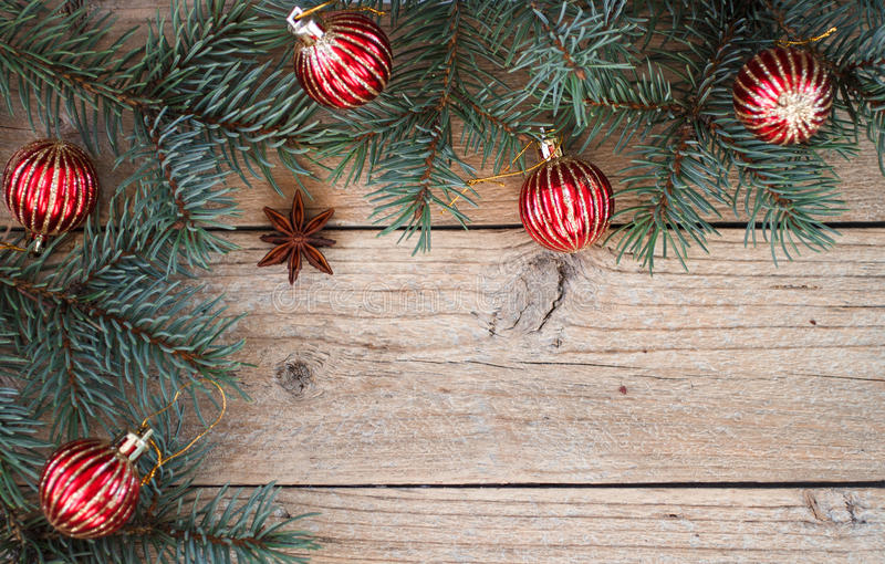 Background of fir branches and red balls. Christmas. Background stock photography