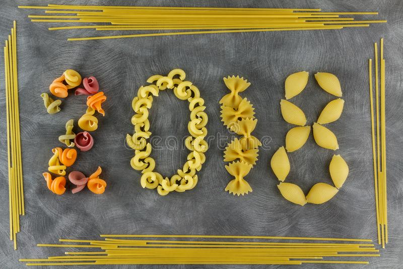 Background of food ingredients.New Year theme. Different kinds of pasta. Macaroni from whole wheat, spaghetti, noodles, tselentani royalty free stock image