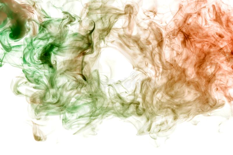Background in the form of a pattern of colored green and red smoke in the shape of a hole, similar to a mystical ghost or an royalty free stock photo