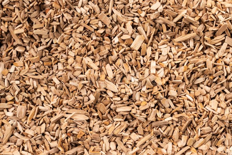 Background in the form of wood chips light brown. Top view royalty free stock images