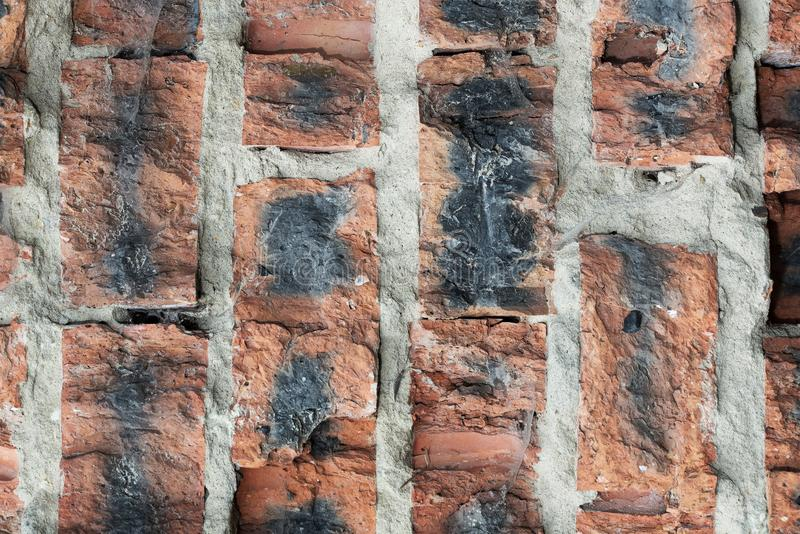 Background from a fragment of an old brick wall from the destroyed brick royalty free stock images